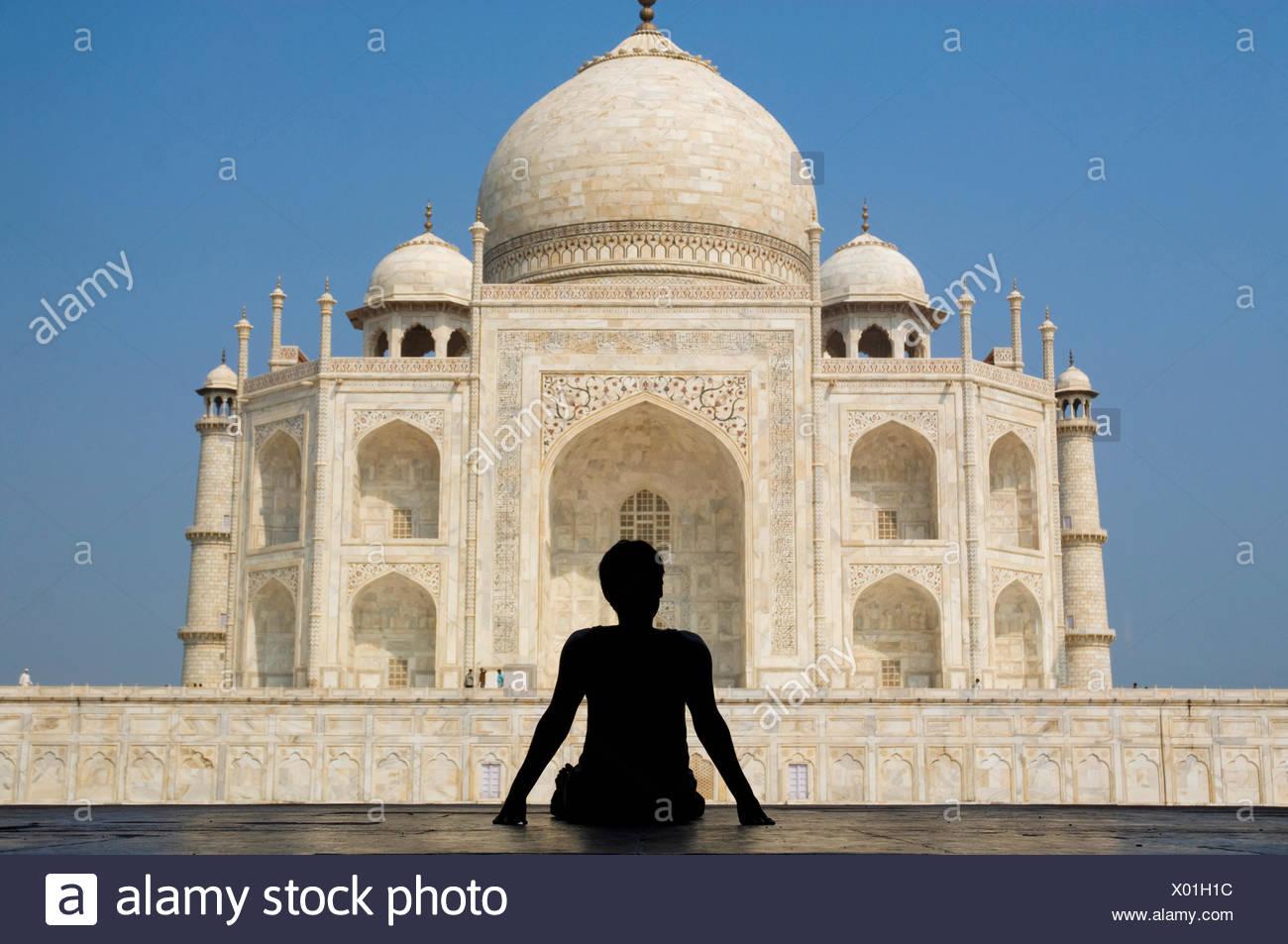 Silhouette Of Woman Admiring The Taj Mahal Rear View Stock