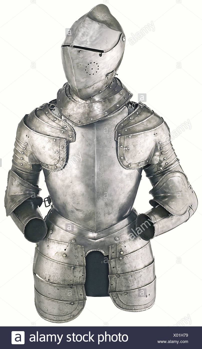 A bright suit of armour, Northern Italy, third quarter of the 16th century. Closed helmet with heavy skull forged from one piece with roped comb-like ridge, riveted iron plume socket at the nape and two brass-lined holes for lining on each side. Two-piece pivoted visor (metal surfaces cleaned), the upper part with two separate eye slits (the handle of the spring catch broken off), the right side with breathing holes and a hook catch, the bevor with spring catch, the throat and neck guard sliding historic, historical, 16th century, defensive arms, weapons, arms,, Additional-Rights-Clearances-NA - Stock Image
