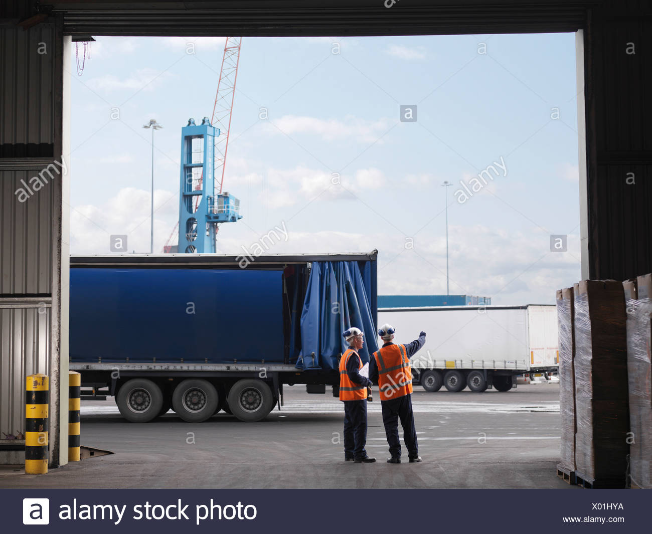 Port Workers Organizing Lorries - Stock Image