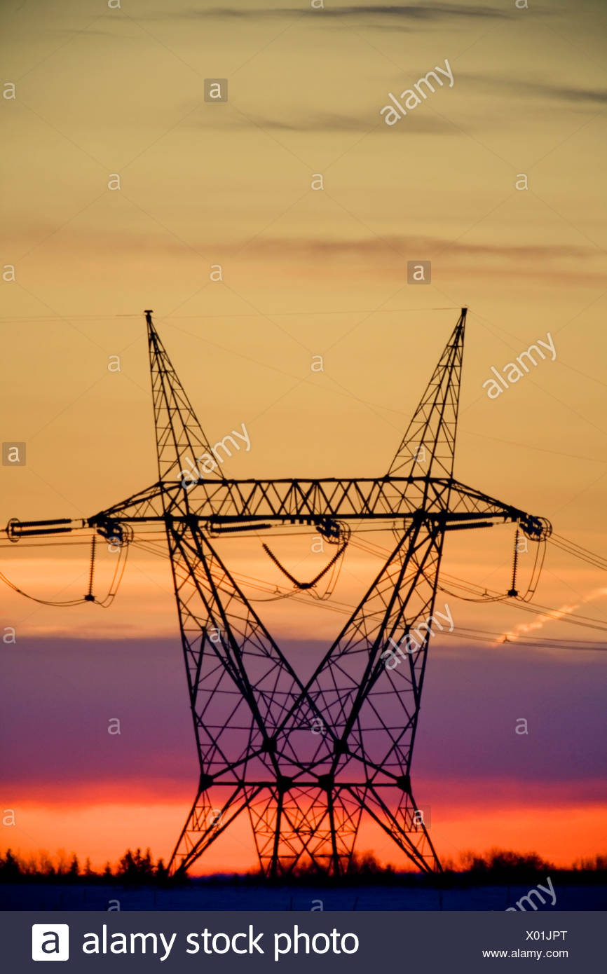 Silhouetted transmission tower - Stock Image