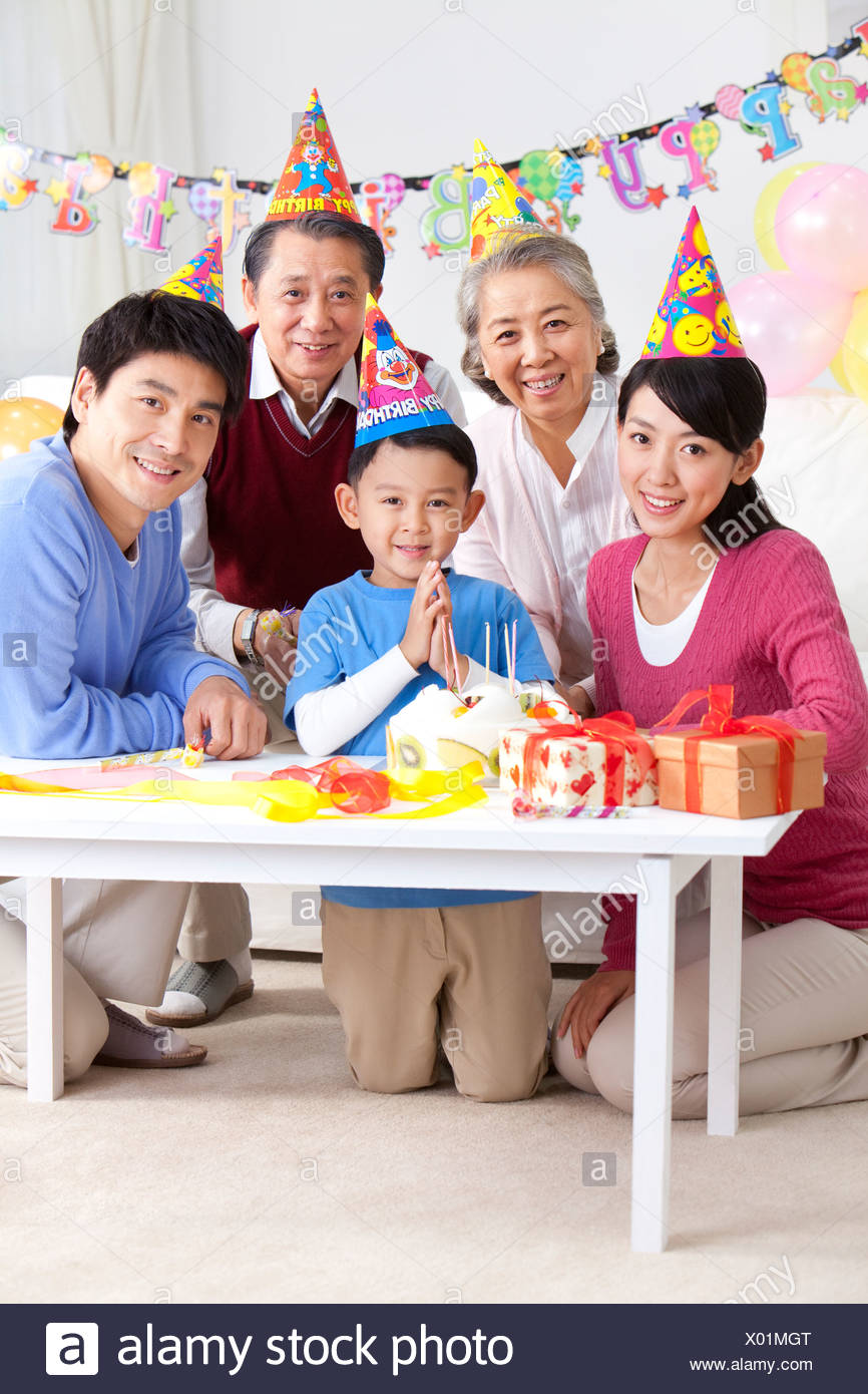 Young Chinese boy's birthday with family Stock Photo