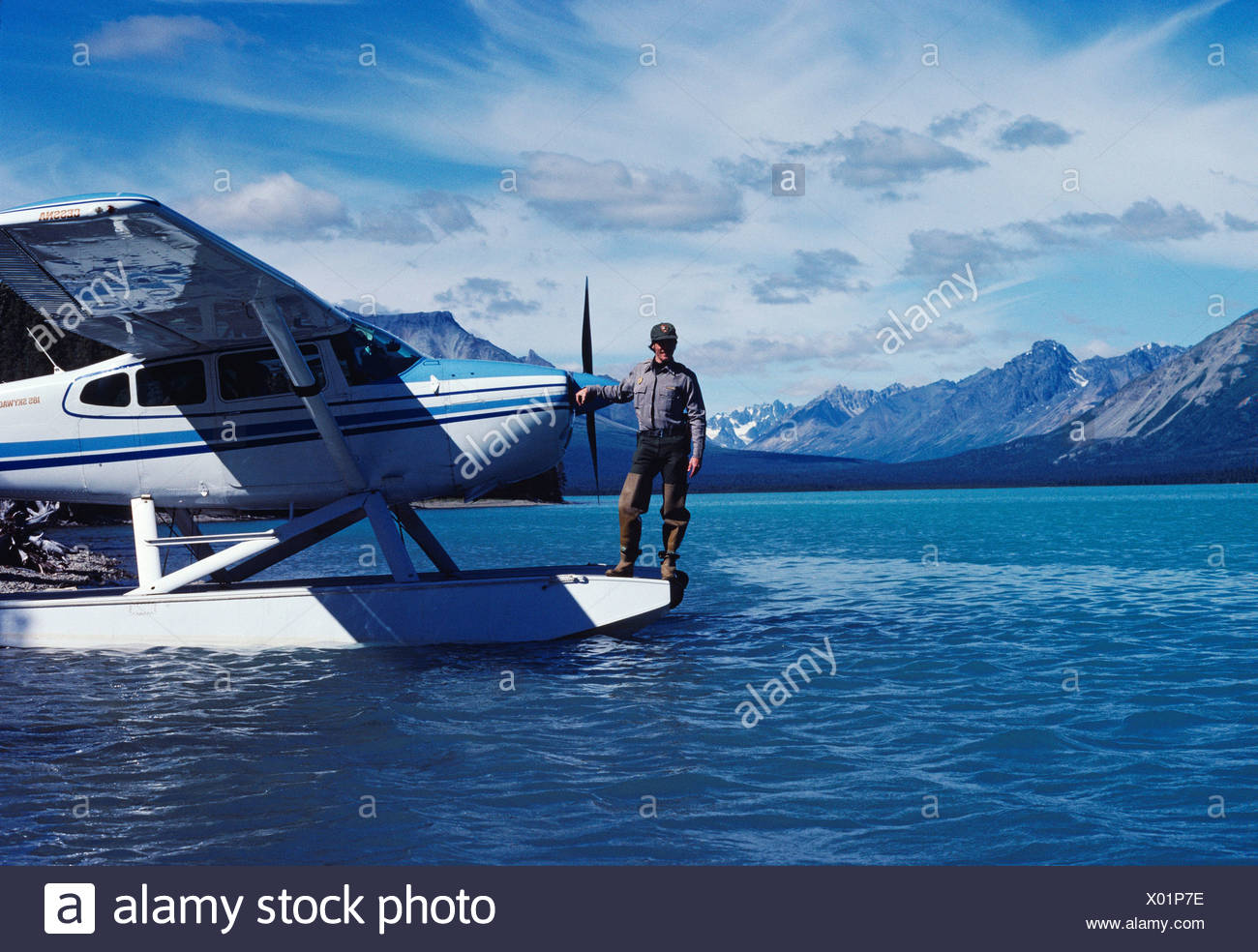 Backcountry Park Ranger Fred Hirschmann on floats Lake Clark National Park's Cessna 185 Lachbuna Lake Lake Clark National - Stock Image