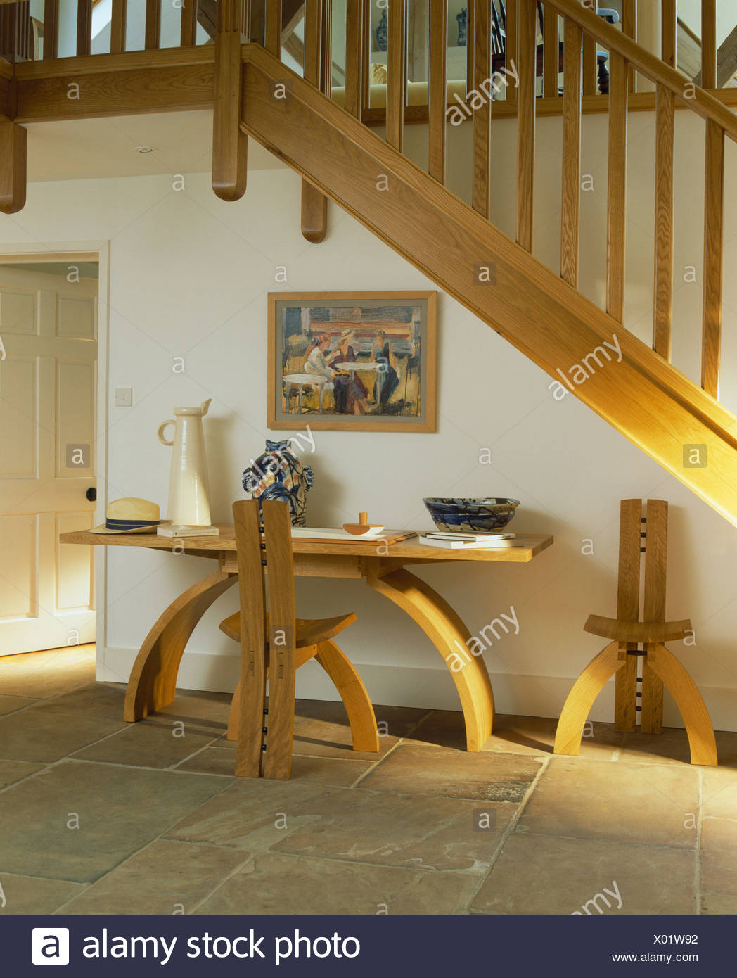 pale wood modern chairs and table below wooden staircase in white rh alamy com  images of dining table under staircase
