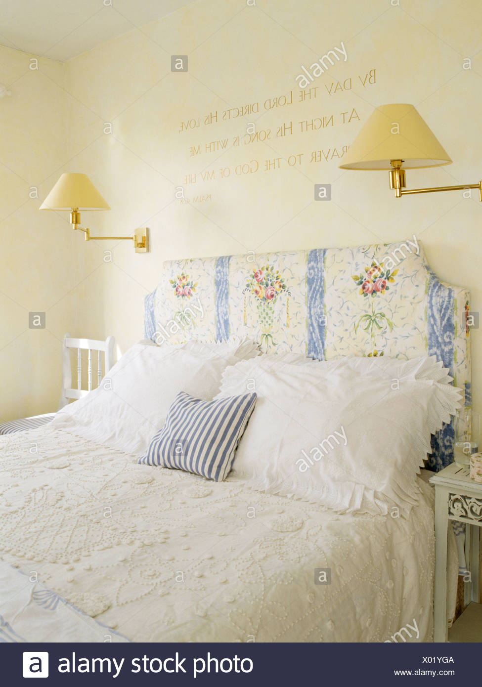 Floral Patterned Headboard On Bed With Lace Bed Cover And