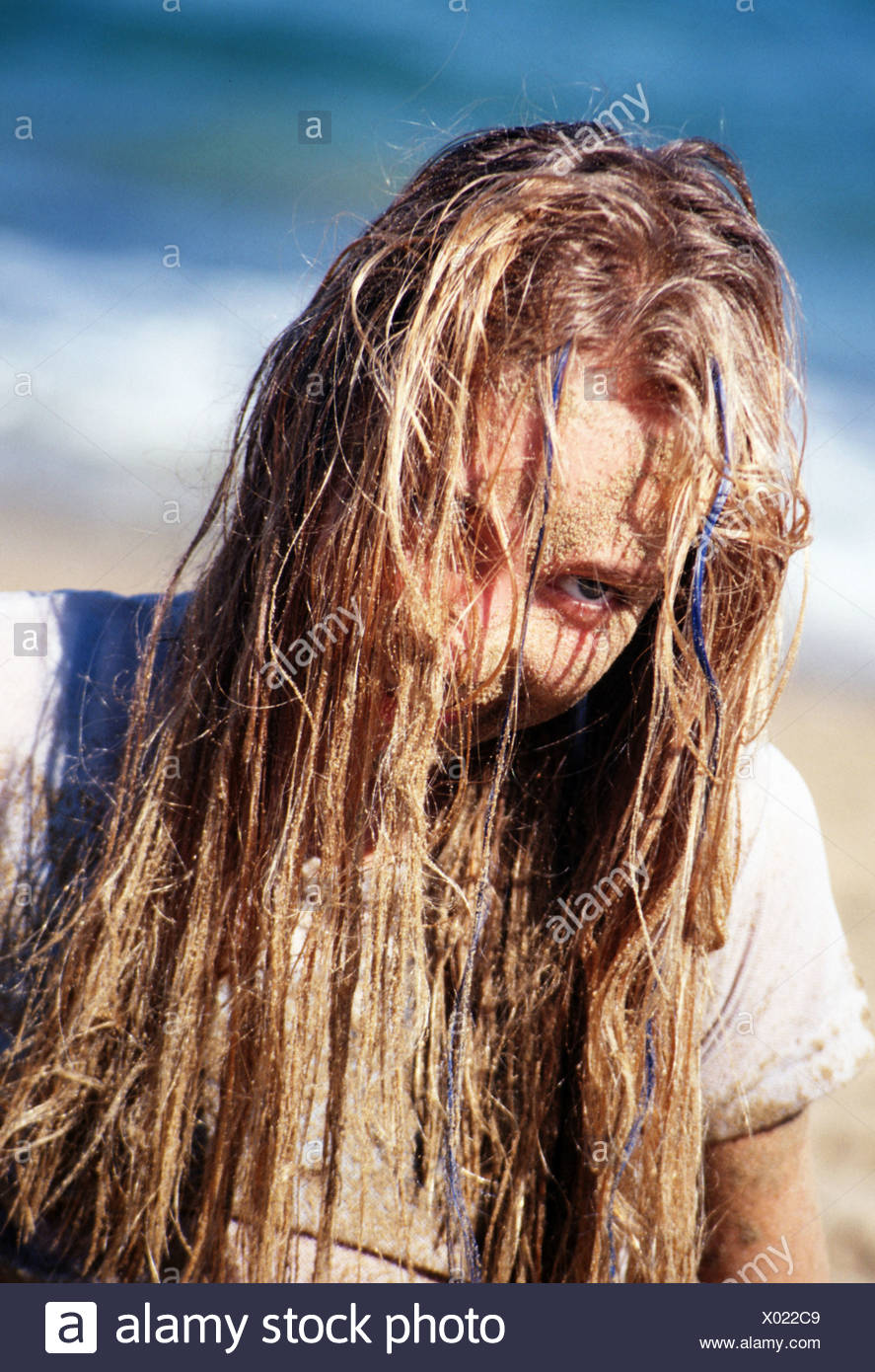 Portrait child 12 Years sand in hair - Stock Image