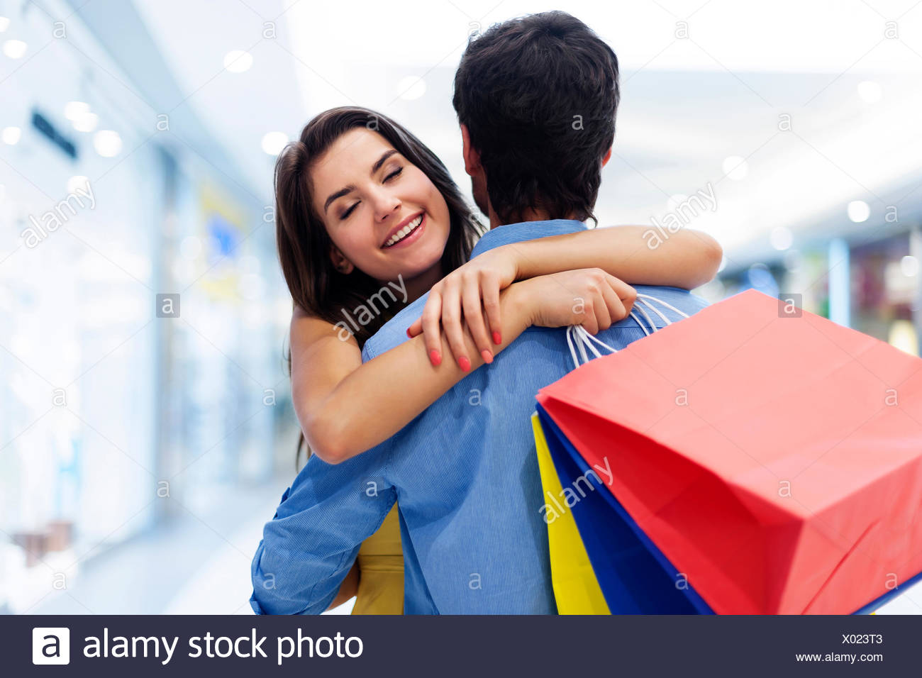 Young beautiful woman welcoming in shopping mall Debica, Poland - Stock Image