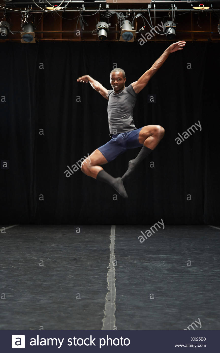 Dancer in midair pose Stock Photo