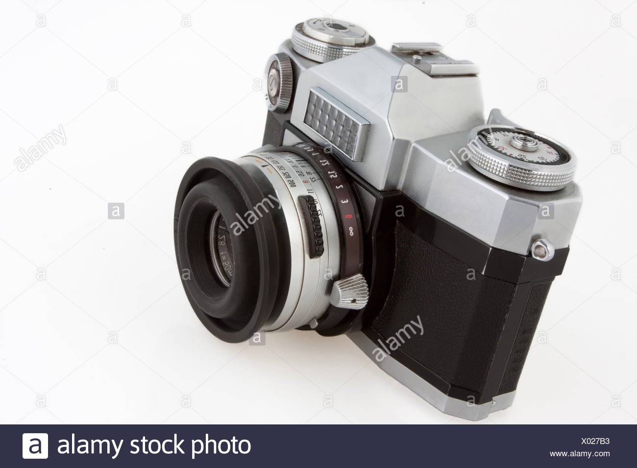 Old vintage SLR film camera isolated on white. - Stock Image