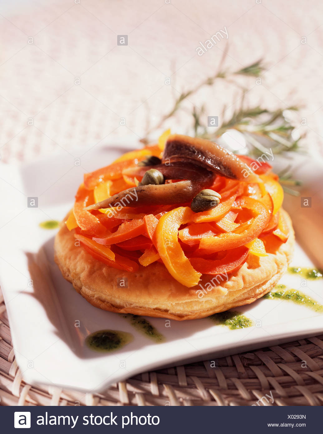cooking Mixed Peppers on Flaky Pastry - Stock Image