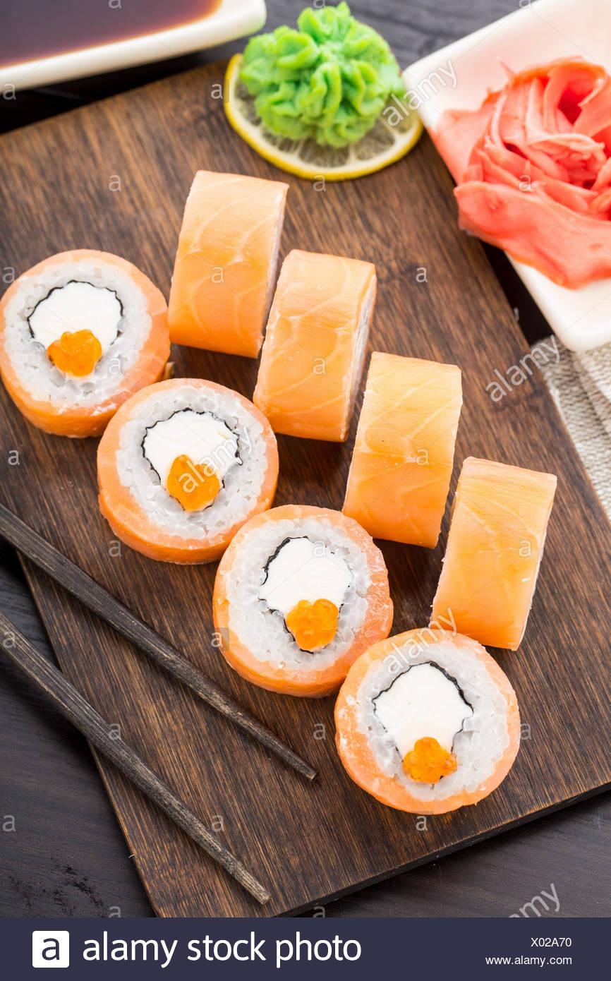 Sushi rolls philadelphia with caviar, salmon and avocado - Stock Image