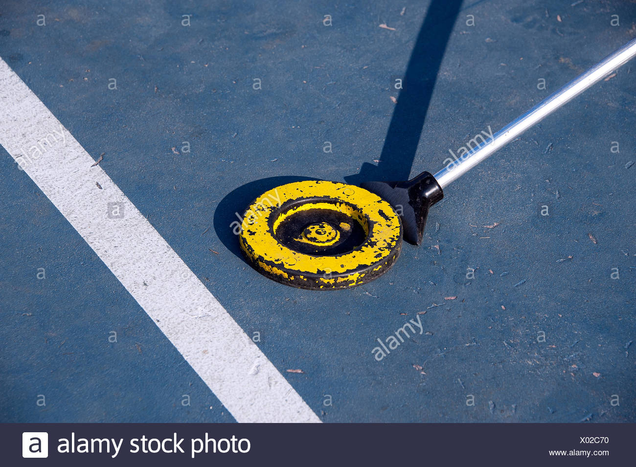 Shuffle board puck and paddle. - Stock Image