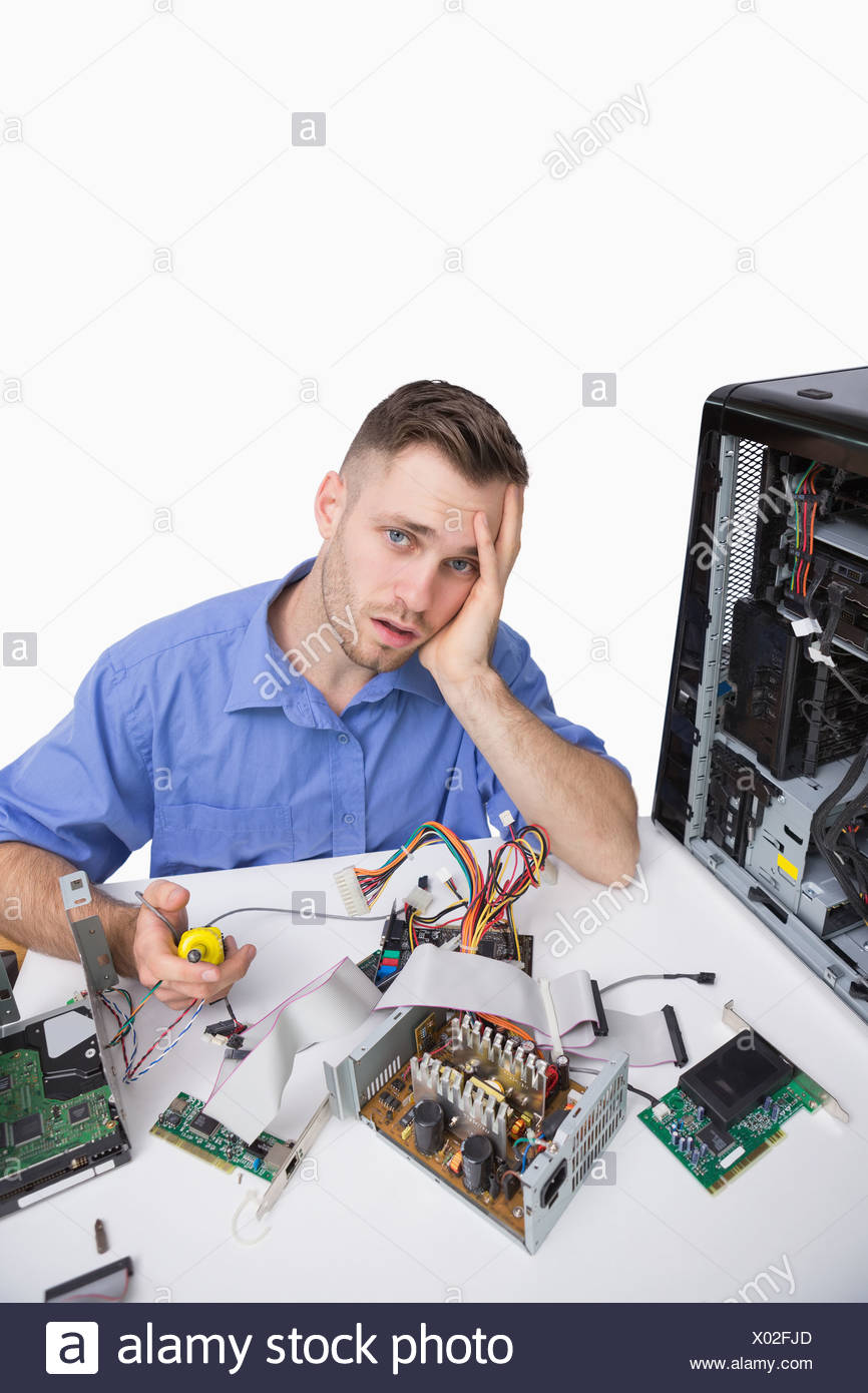 Portrait of tired computer engineer with cpu parts Stock Photo