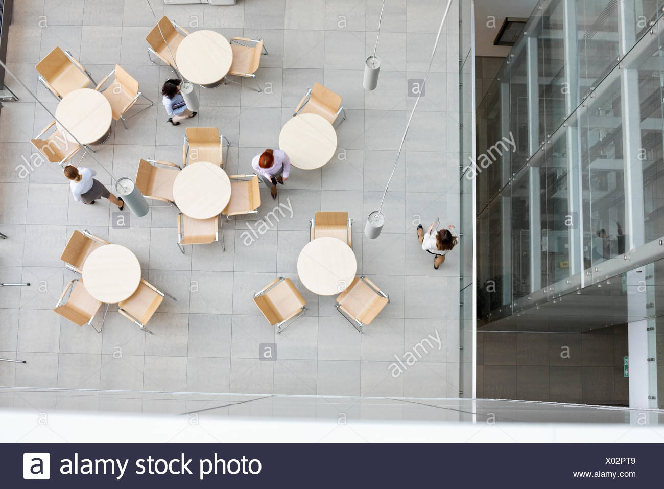 High angle view of businesswomen walking at office canteen - Stock Image