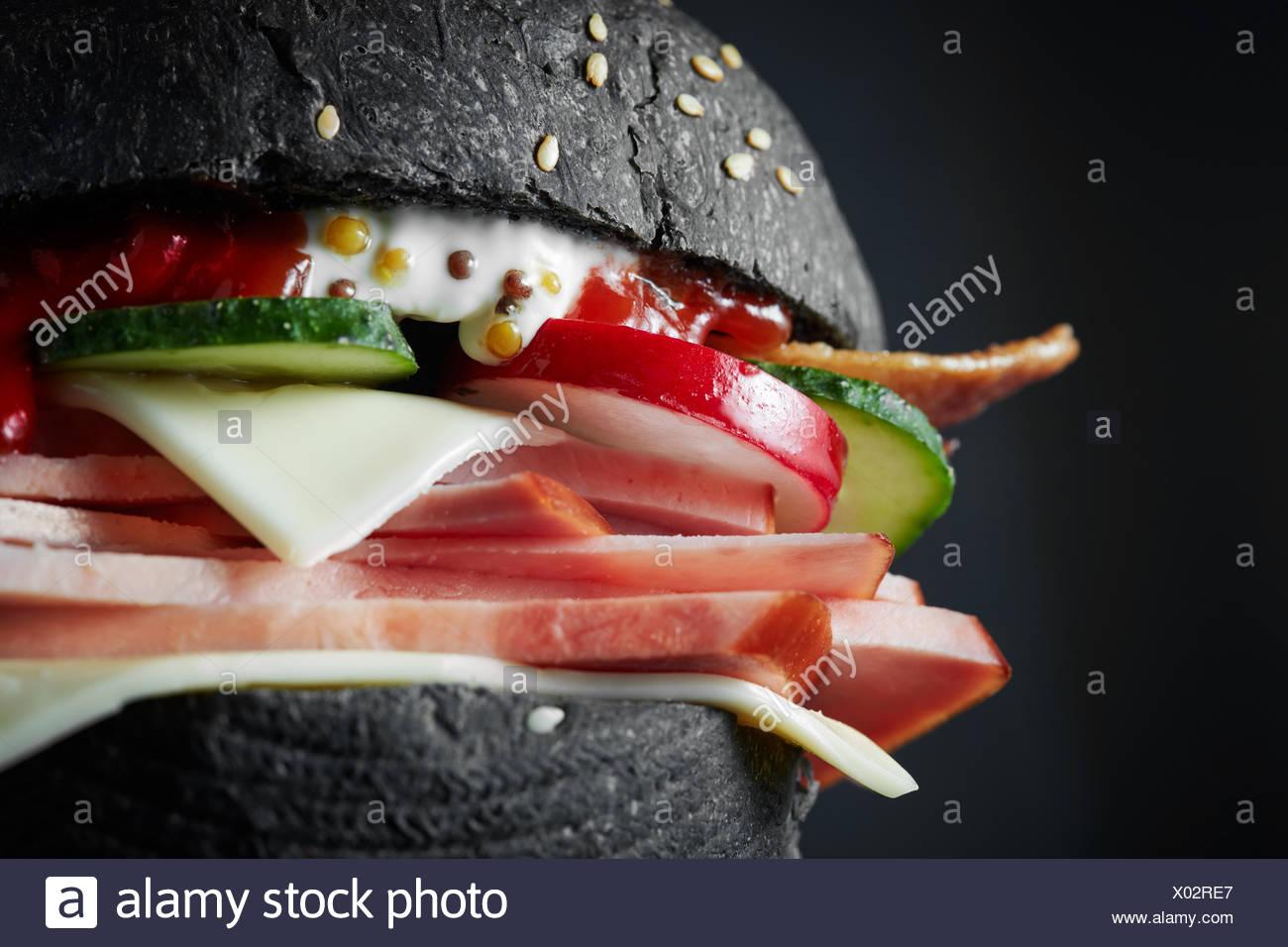 macro Black burger - Stock Image