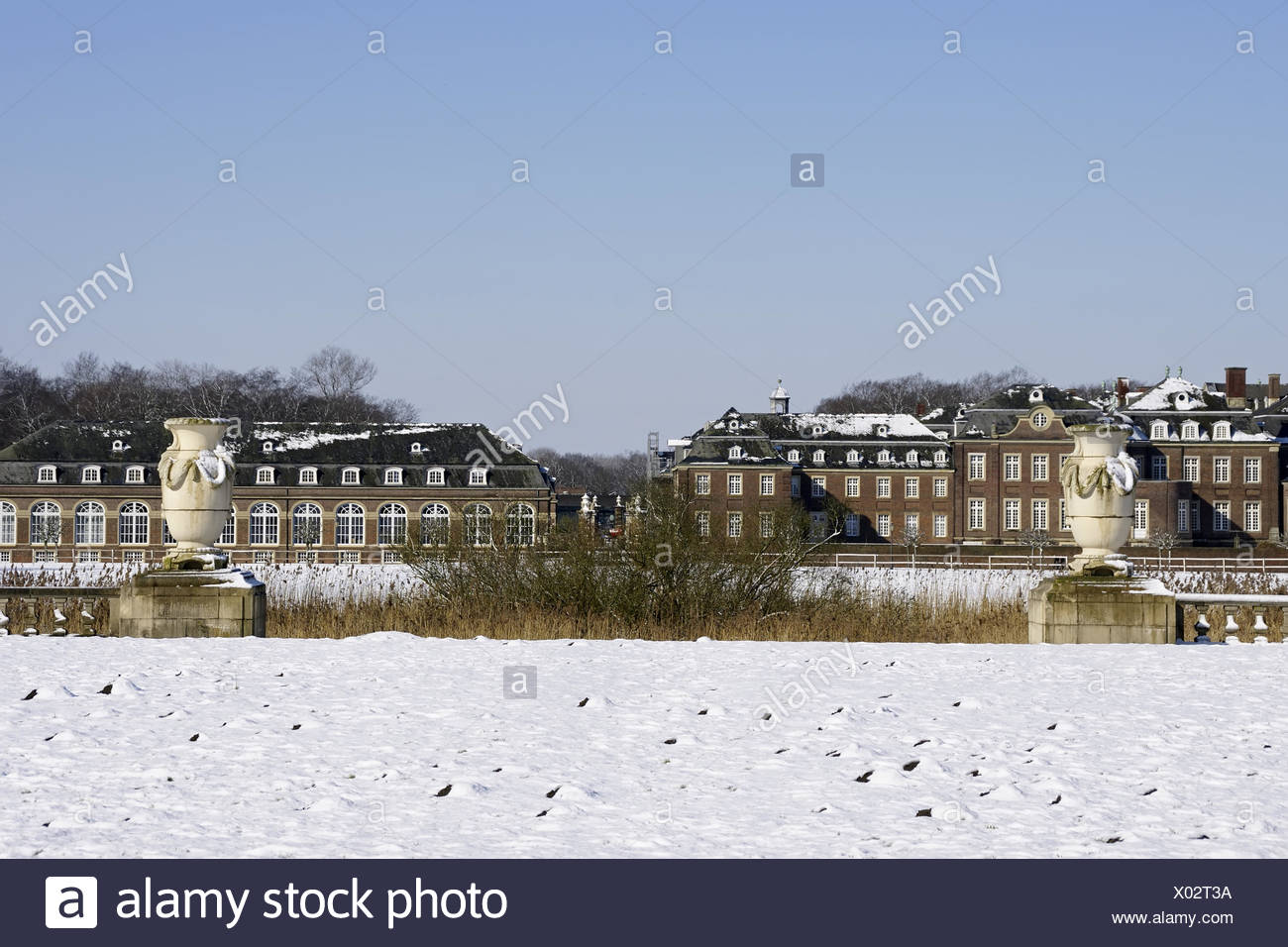 Moated castle Nordkichen  - snow-covered, Germany - Stock Image