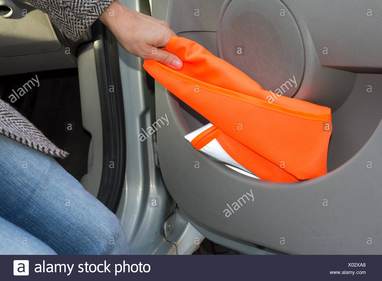 reflective vest in car door - Stock Image