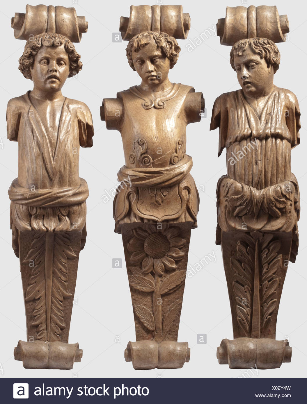 Three German caryatid pillars, 19th century in the style of the 17th century Elaborately carved, three quarter relief oak pillar overlays. Slightly different pillar figures in the shape of youths in ancient dress. The bases of each in the shape of massive volutes. Height of each 96 cm, historic, historical, 19th century, handicrafts, handcraft, craft, object, objects, stills, clipping, clippings, cut out, cut-out, cut-outs, sculpture, sculptures, statuette, figurine, figurines, statuettes, fine arts, art, Additional-Rights-Clearences-NA - Stock Image