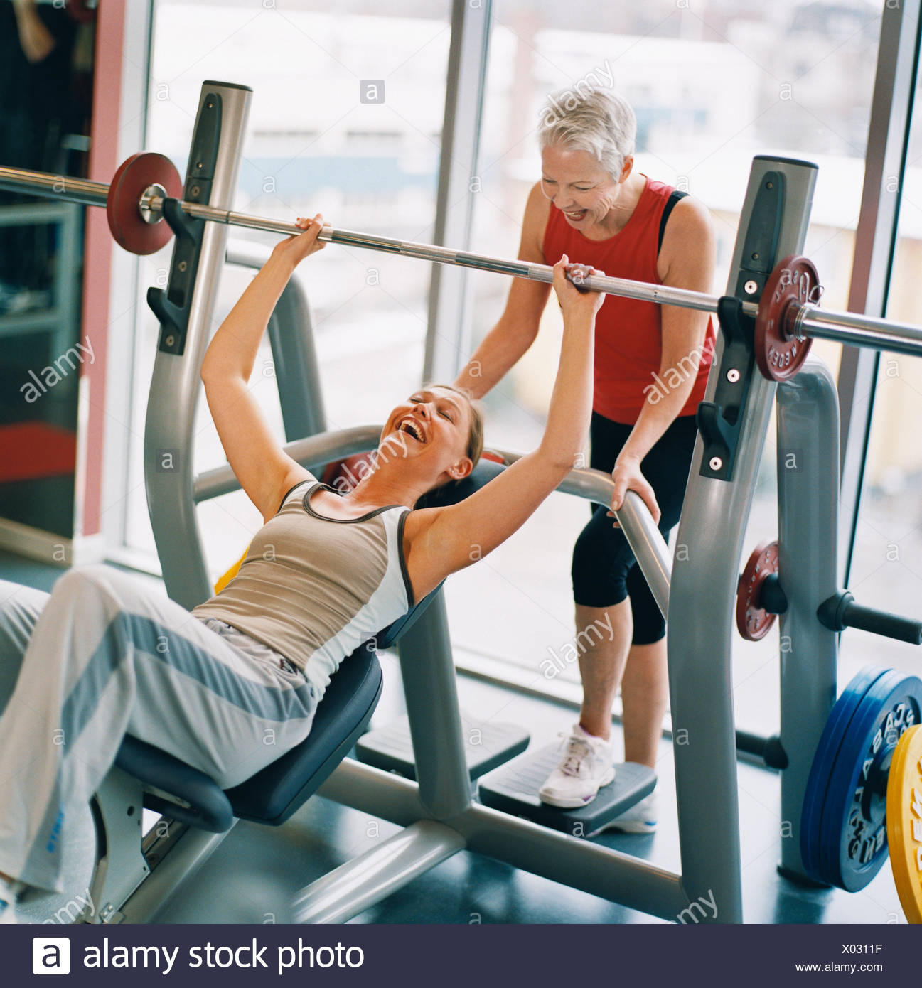 20-24 years 70-74 years 75-79 years activity adults only athlete bodybuilding color image elderly woman exercising feelings - Stock Image