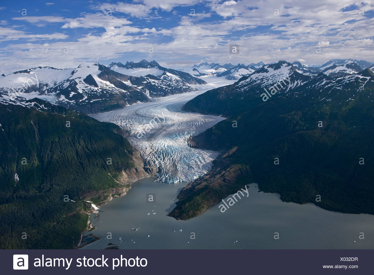 Aerial of Mendenhall Glacier winding its way down from the Juneau Icefield to Mendenhall Lake in Tongass National Forest, Alaska - Stock Image