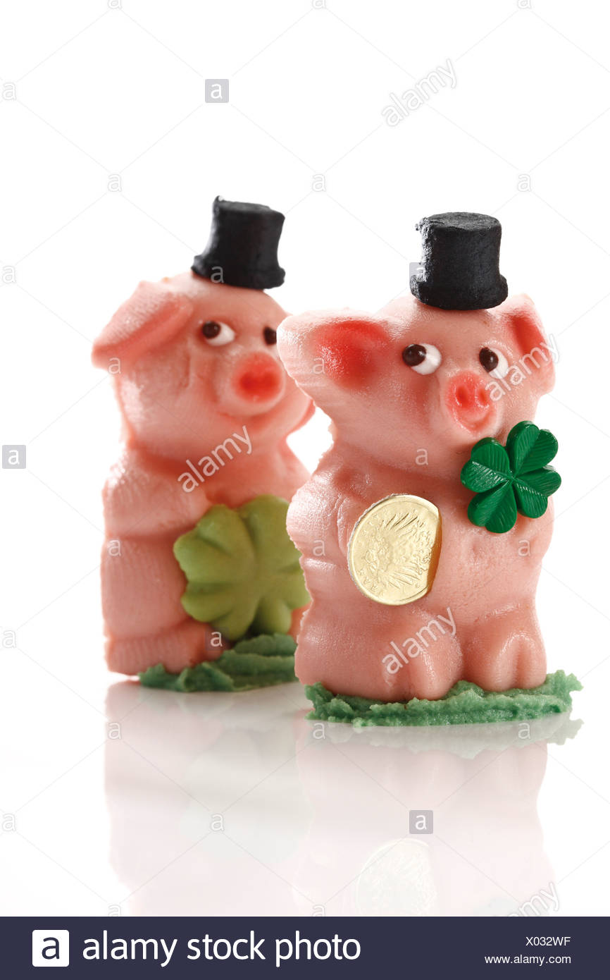 Two marzipan pigs, lucky pigs made of marzipan - Stock Image