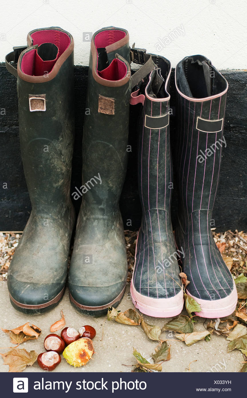 Two pairs of wellington boots - Stock Image