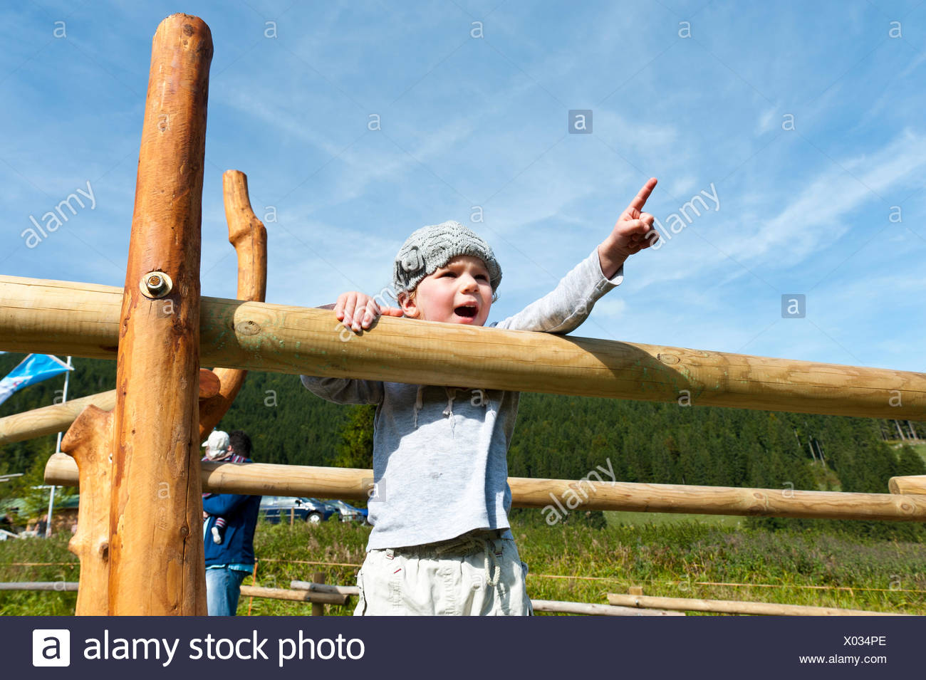Little girl pointing into a direction with her finger, upwards, Bavaria, Germany - Stock Image