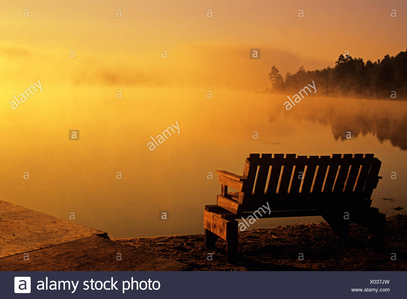 Bench In Morning Fog Alongside Tilton Lake Sudbury Ontario Canada