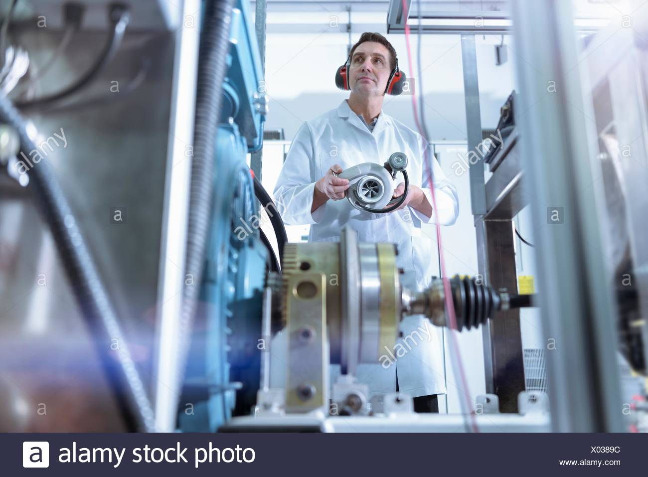 Scientist in turbo charger automotive research laboratory - Stock Image