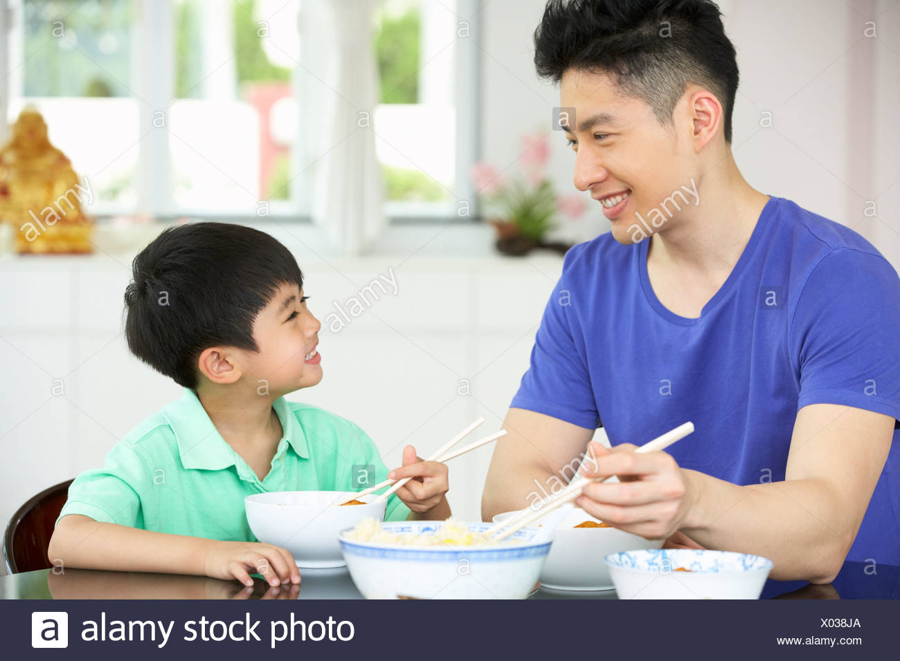 Image result for images of father and son eating noodles together