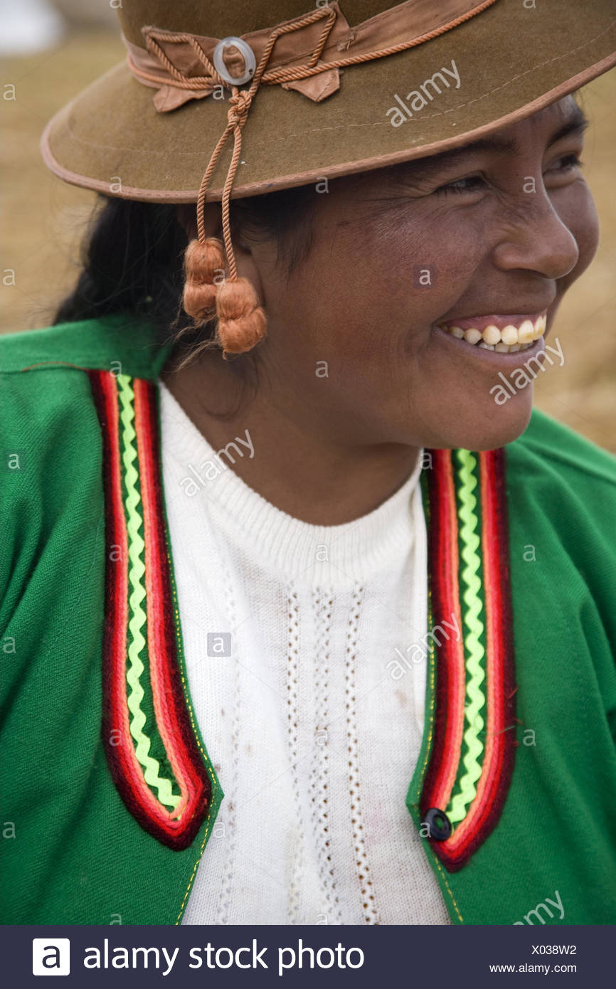 Peru, Titicacasee, Uros Iceland, Uro woman, smile, portrait, curled, South America, Bolivia, Titicaca lake, Uro strain, woman, people, local, side view, happy, smile, clothes, tradition, care, headgear, - Stock Image