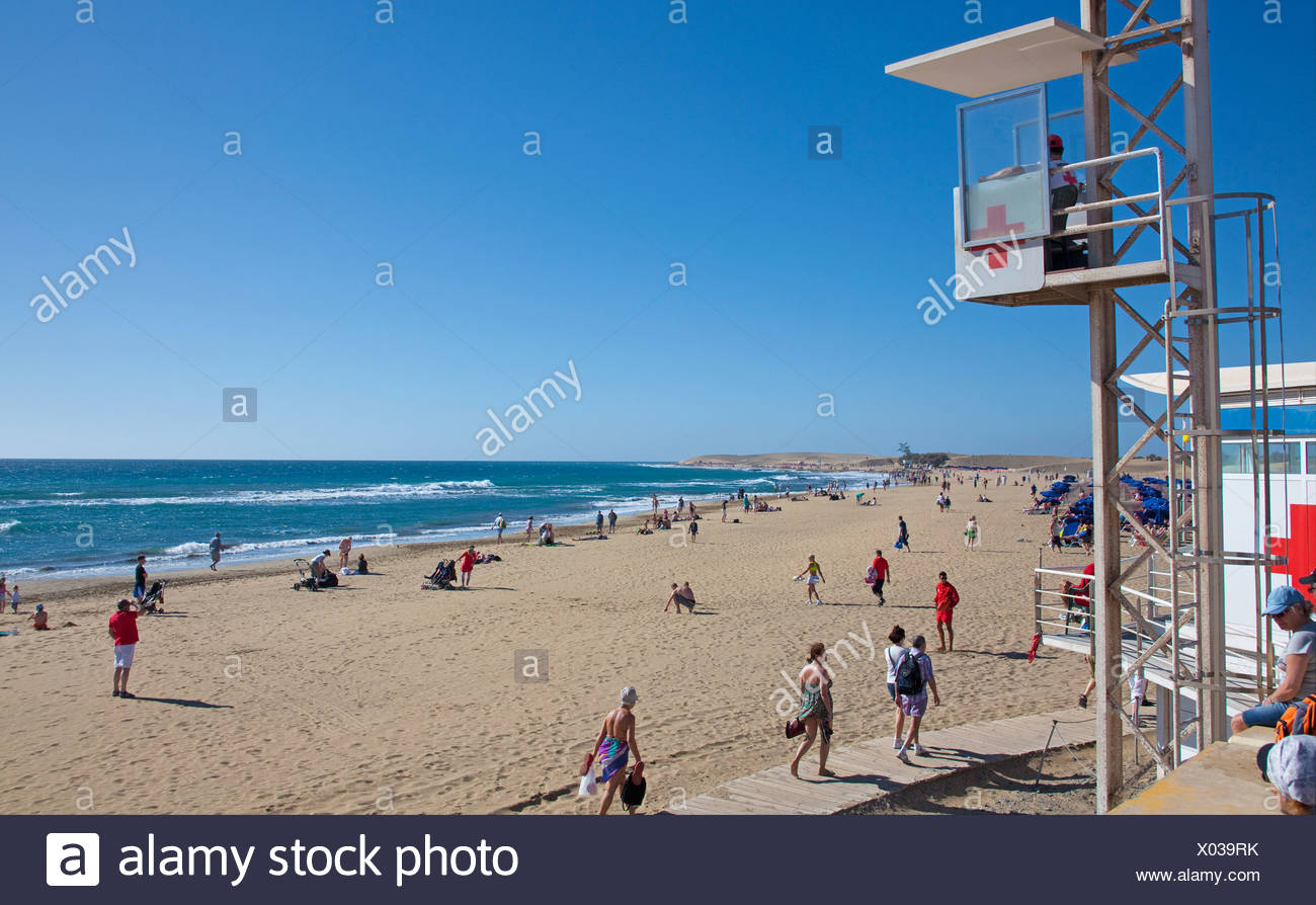 Lifeguard at the beach of Maspalomas, with the Dunes of Maspalomas at the rear, nature reserve, Gran Canaria, Canary Islands - Stock Image
