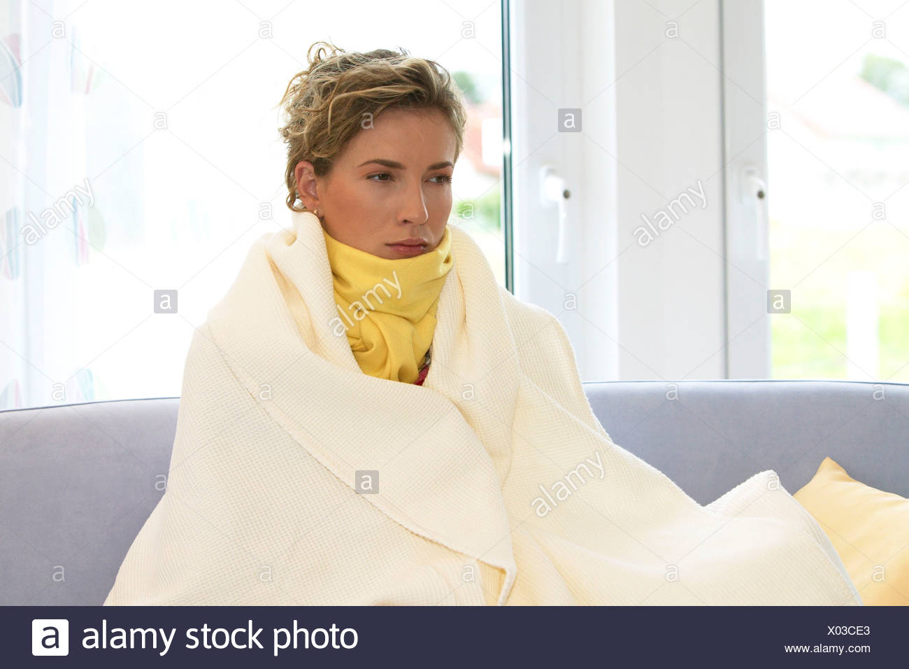 woman having a cold - Stock Image