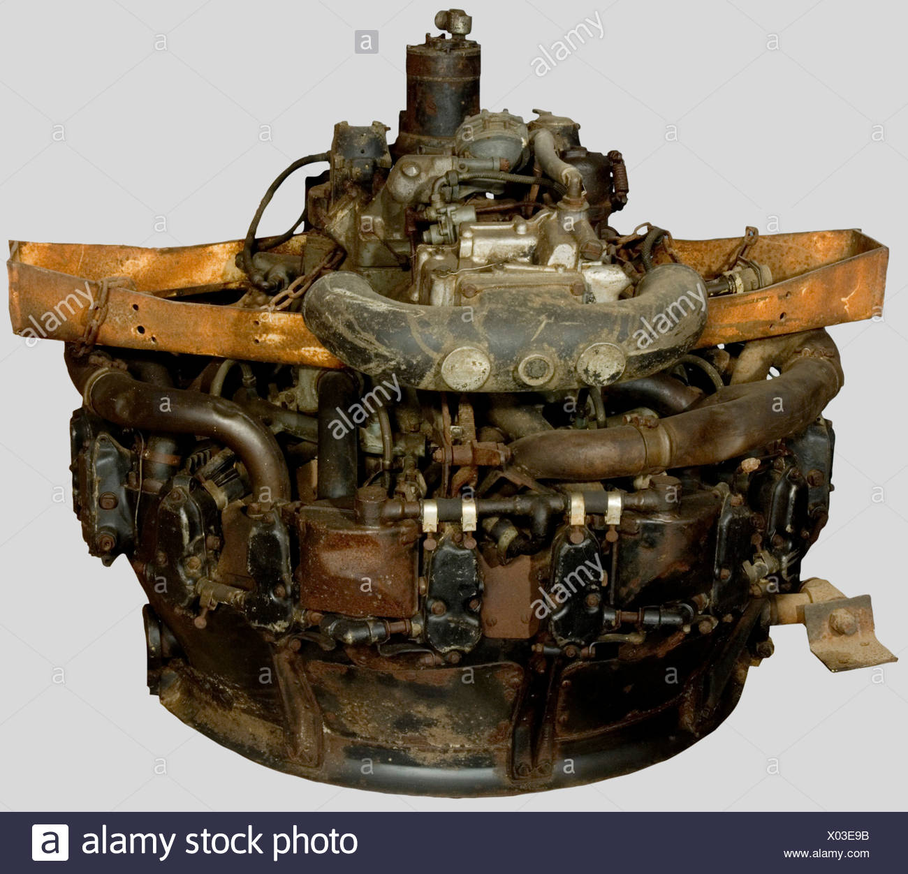 A 9-cylinder US airplane engine, for a Continental Airlines plane. Very corroded., historic, historical, 20th century, technical, technic, material, materials, device, devices, equipment, equipments, utensil, piece of equipment, utensils, technology, militaria, military, object, objects, stills, clipping, clippings, cut out, cut-out, cut-outs, Additional-Rights-Clearances-NA - Stock Image