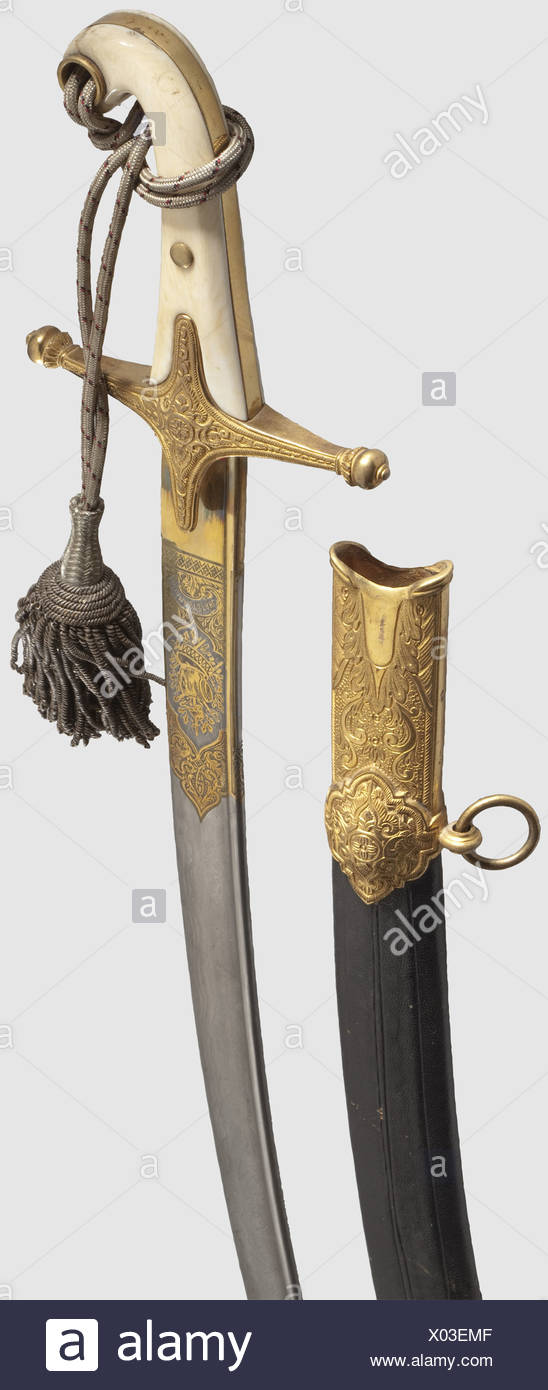 """A sabre à la Mameluke, 2nd half of the 19th century. Curved pipe-back Damascus steel blade with a pandour point, lavishly etched and gilded at the forte, with """"Eisenhauer"""" inscribed on the obverse side, and Damaststahl"""" (Damascus Steel) on the reverse side. Gold-plated brass hilt with floral ornamentation in relief and ivory grip scales, one slightly damaged. Black leather scabbard with brass mountings also gilded and decorated en suite. Attached sword-knot with red and black interweave. Length 98 cm. Splendid officer's weapon in beautiful, unaltered condition,, Additional-Rights-Clearences-NA Stock Photo"""