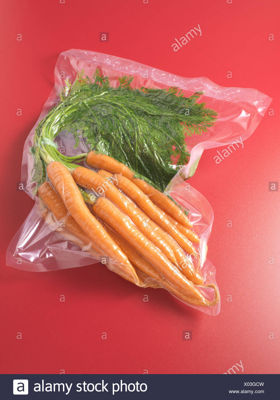 Vacuum packed carrots - Stock Image