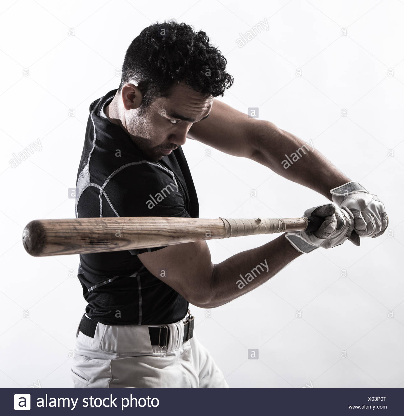 Portrait of a man holding a baseball bat - Stock Image