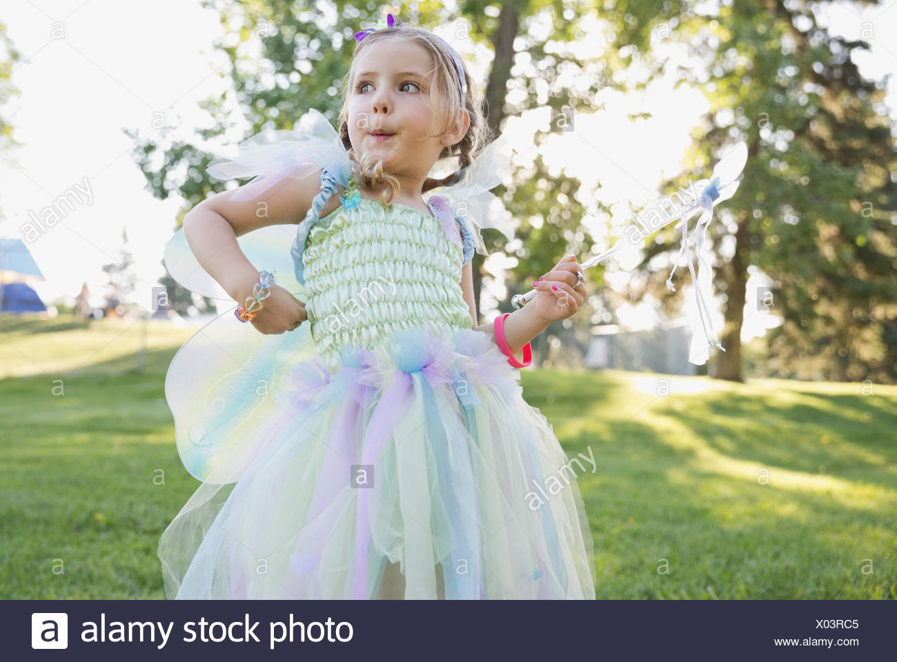 Cute girl wearing fairy costume outdoors - Stock Image