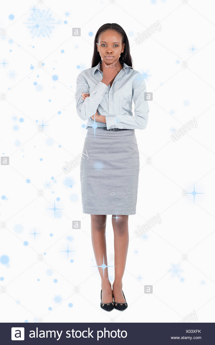 Composite image of portrait of a doubtful businesswoman - Stock Image