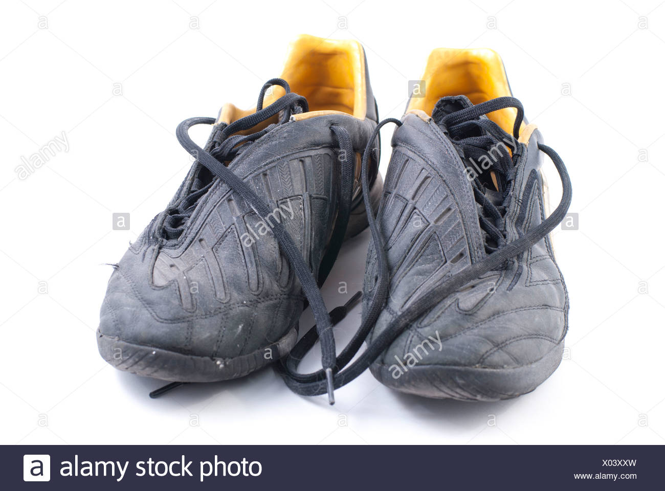362a4398f two old black soccer shoes Stock Photo: 275452881 - Alamy