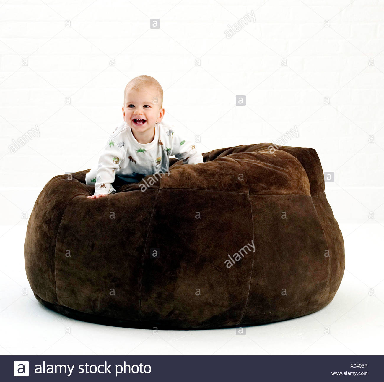 Admirable Male Baby Wearing White Patterned Babygro Crawling On Large Dailytribune Chair Design For Home Dailytribuneorg