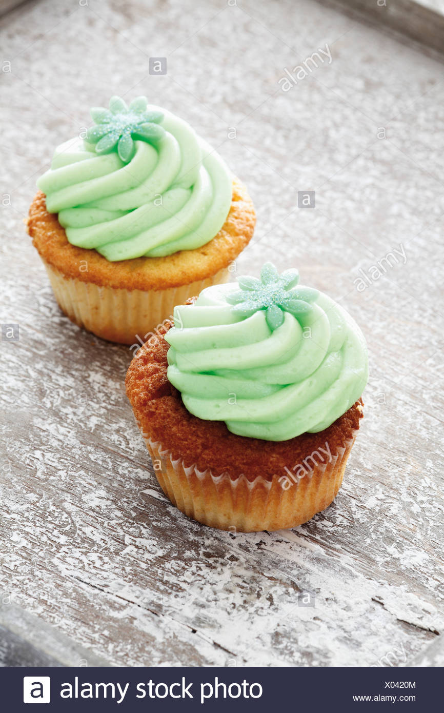 Close up of buttercream woodruff cupcakes - Stock Image