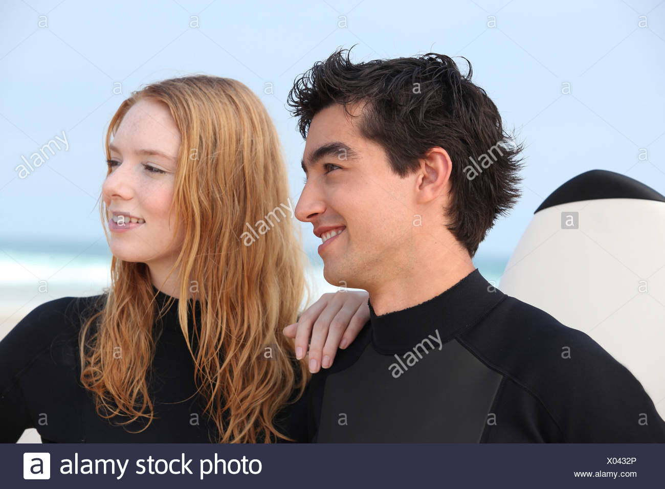 Couple of surfers Stock Photo