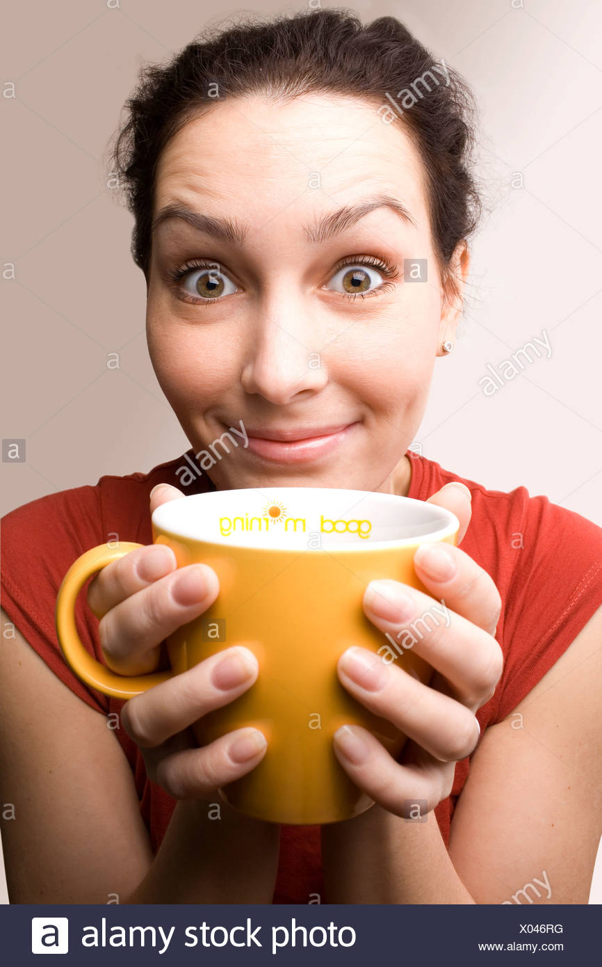 positive girl with yellow cup titled 'Good morning' - Stock Image