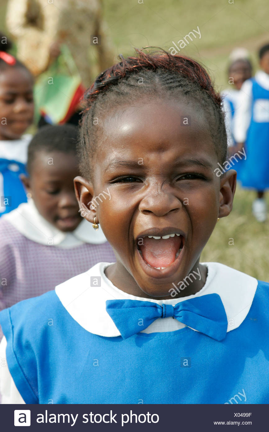 Girl wearing a uniform yelling loudly, Pre-school children during morning exercise, Buea, Cameroon, Africa - Stock Image