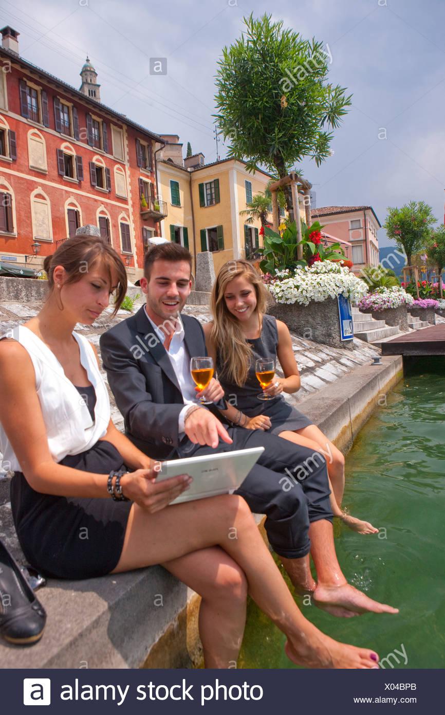 Break, Stop, Lake Lugano, Morcote, work, job, occupation, profession, occupations, professions, group, drinking, canton, TI, Tic - Stock Image
