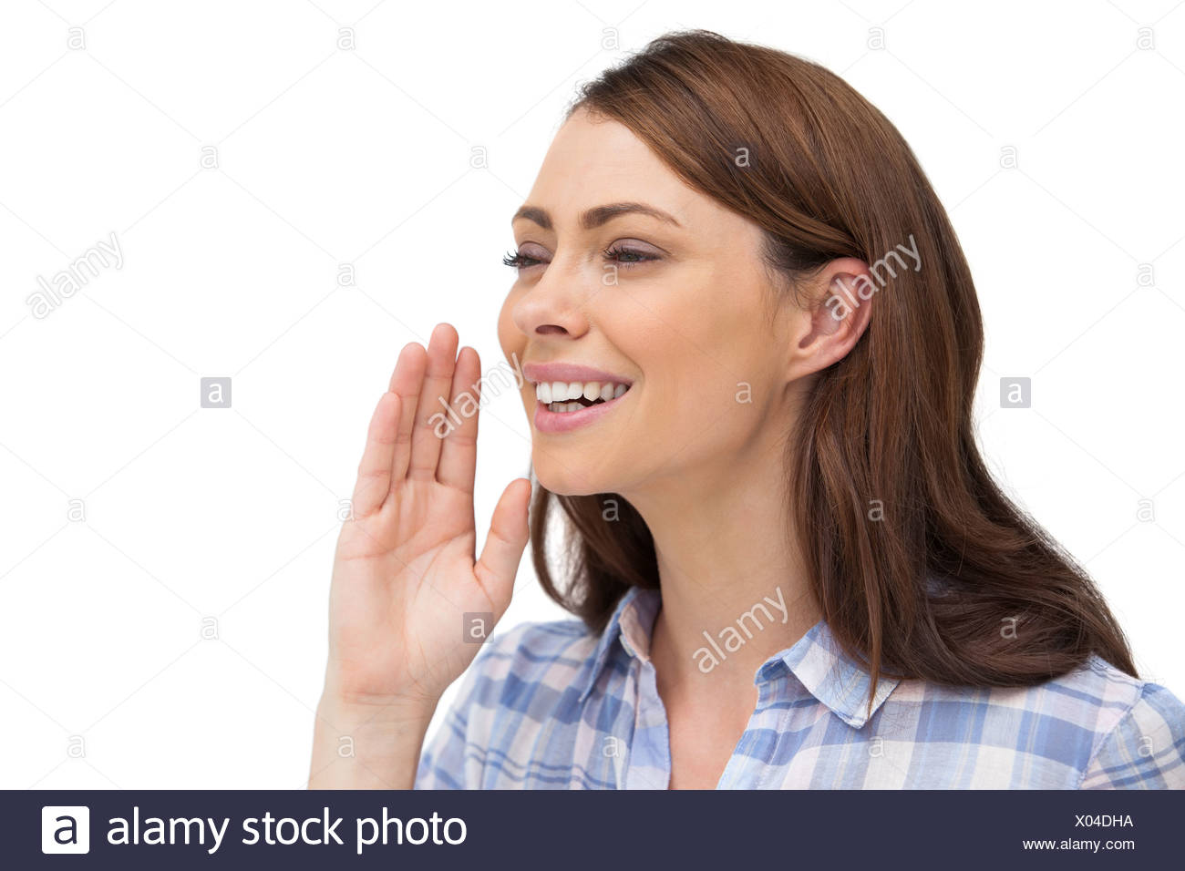 Smiling woman placing her hand to say something - Stock Image