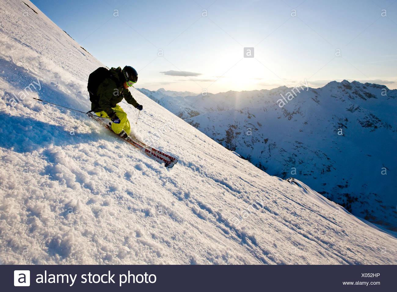 Freeride skier during descent, Arlberg, Verwall Group, North Tyrol, Austria - Stock Image