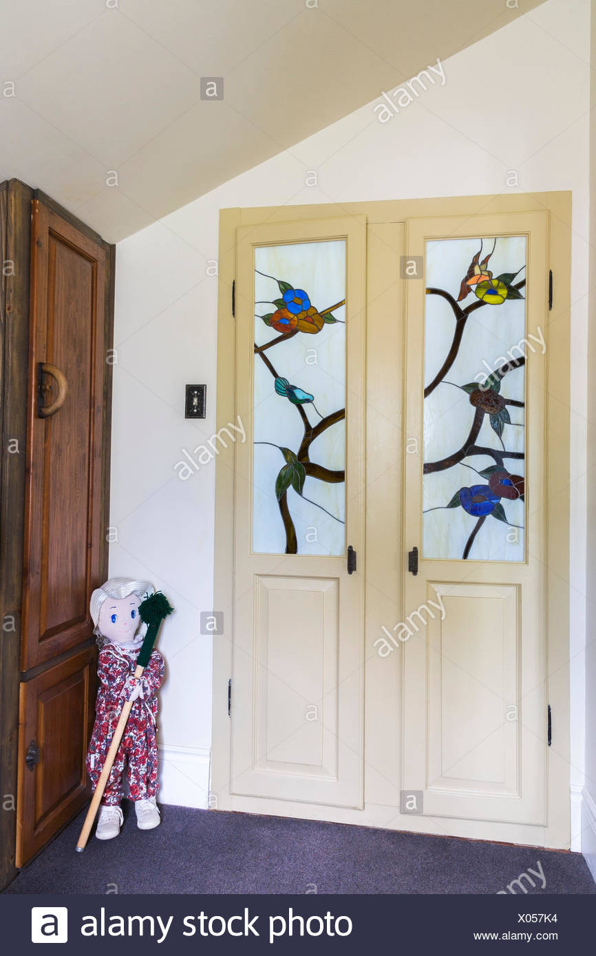 Entryway With Ragdoll And Wooden Built In Armoire And Closet Doors With  Satined Glass Panels