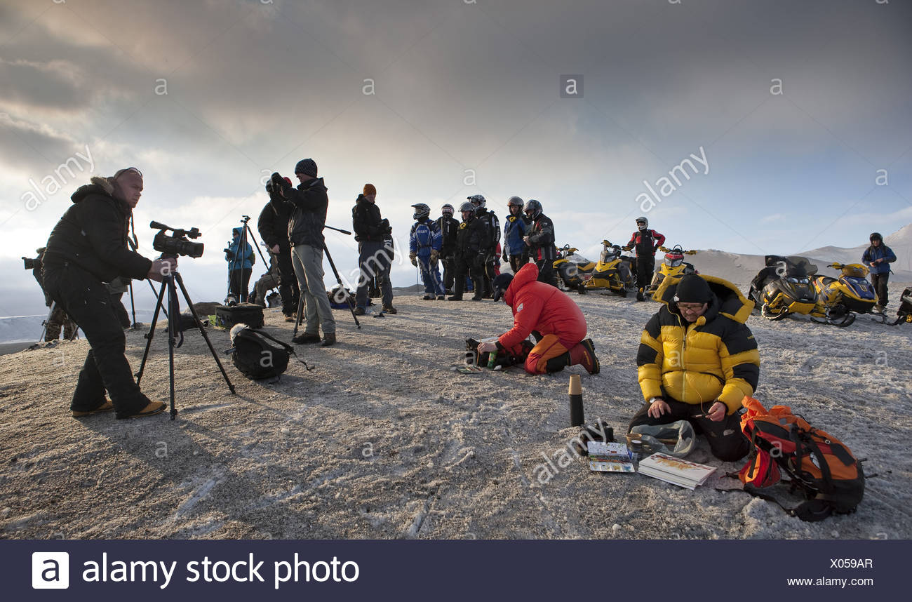 Tourist and scientists-volcano eruption in Iceland at Fimmvorduhals,a ridge between Eyjafjallajokull and Myrdalsjokull glaciers - Stock Image