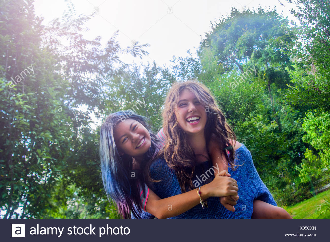 Two teenagers dancing messing around, outdoors - Stock Image